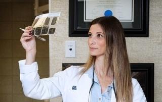 Dr Katia holding x ray