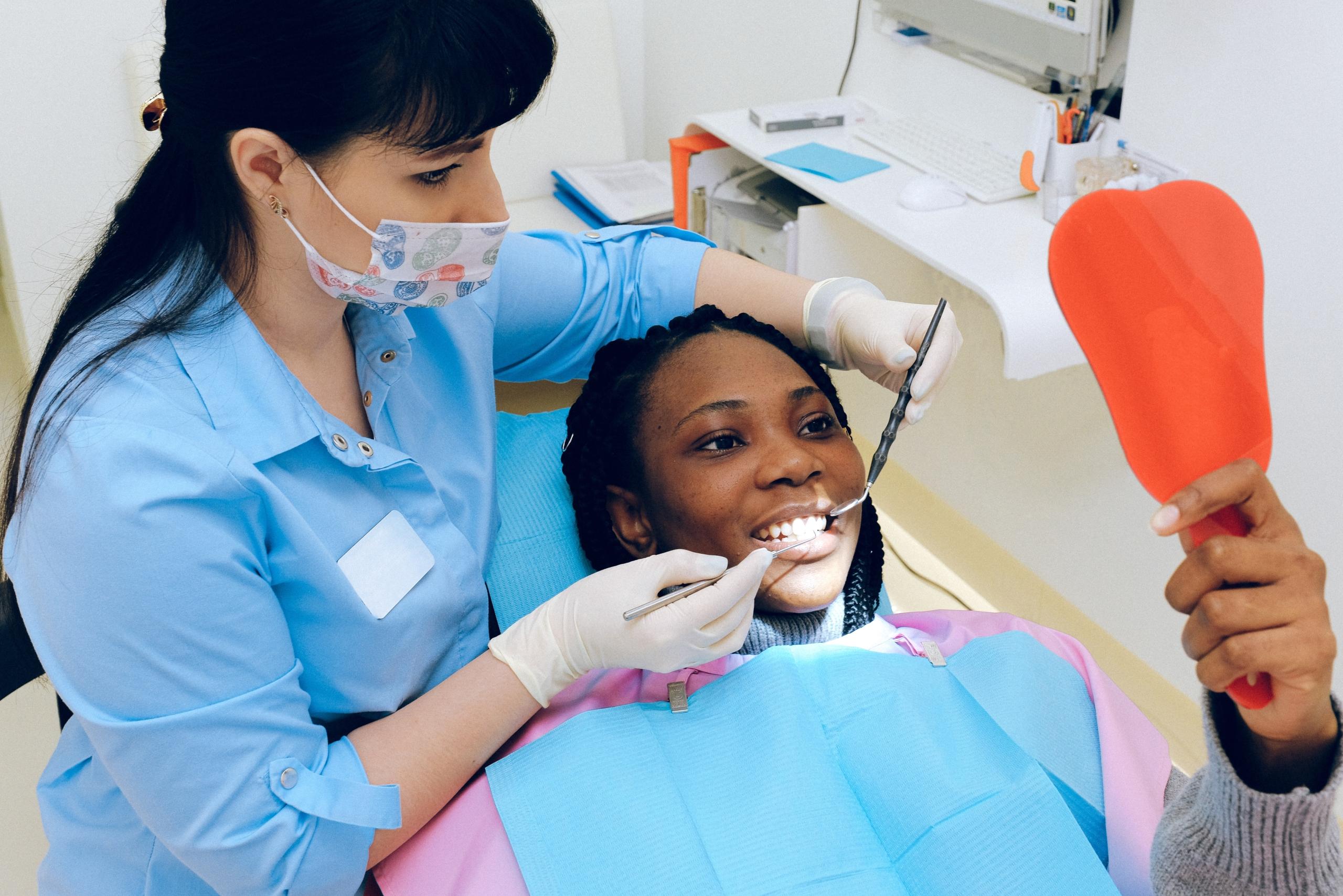 Dental Patient Looking In the Mirror